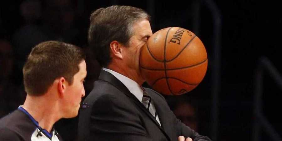 amazing-photo-captured-exact-moment-an-nba-coach-was-hit-in-the-face-with-a-ball
