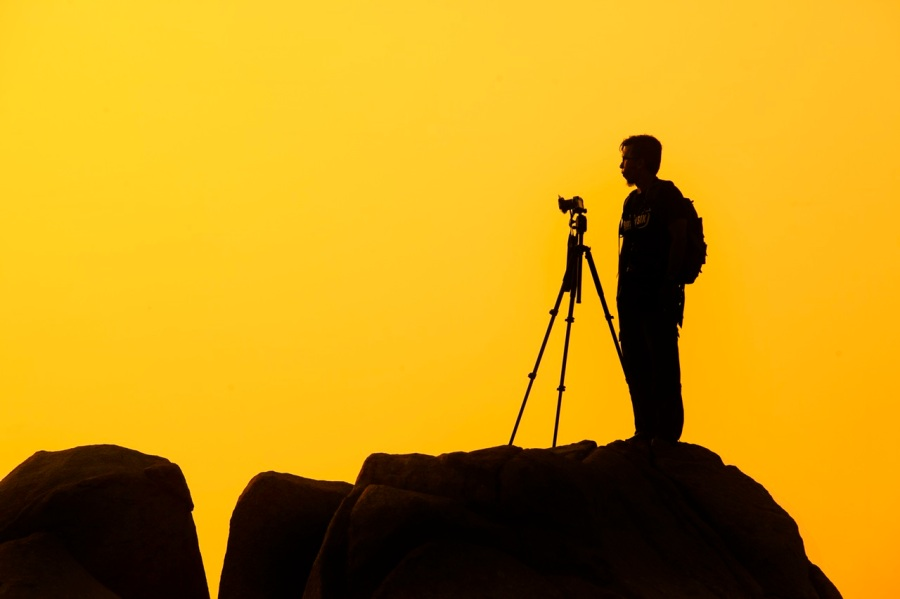 man-with-camera-yellow-background-med.jpg
